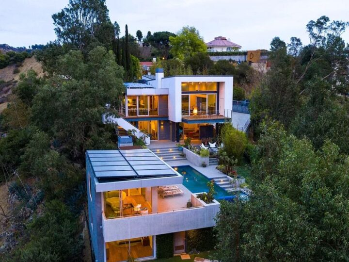 The Los Angeles Home is a gated modern classic estate perched atop the prestigious Oaks enclave of Los Feliz now available for rent. This home located at 2511 Wild Oak Dr, Los Angeles, California; offering 5 bedrooms and 6 bathrooms with over 4,100 square feet of living spaces.