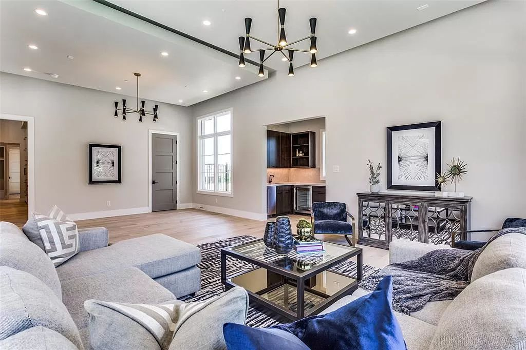 The Transitional Home in Texas is a luxurious new construction with amazing open floor plan and an abundance of natural light now available for sale. This home located at 1826 Seville Cv, Westlake, Texas; offering 5 bedrooms and 7 bathrooms with over 6,000 square feet of living spaces.