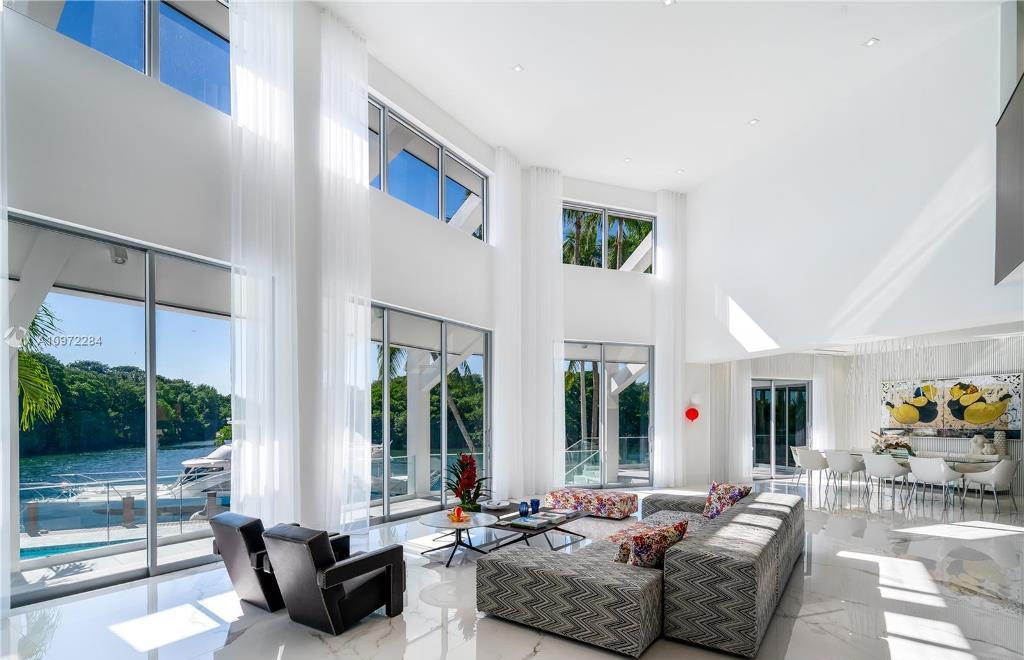 The Florida Mansion is a Completely rebuilt with custom chic modern estate nestled in the guard-gated community now available for sale. This home located at 6946 Sunrise Ct, Coral Gables, Florida; offering 5 bedrooms and 5 bathrooms with over 6,800 square feet of living spaces.