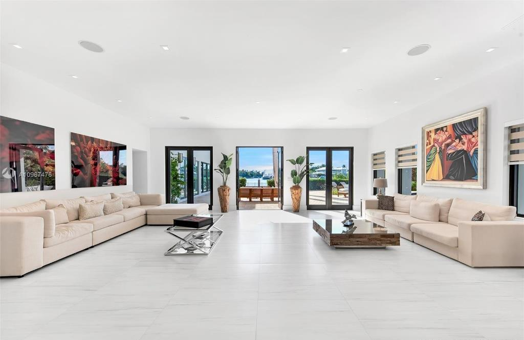 The Miami Beach Waterfront Home is a stunning estate with open water views on the prestigious North Bay Road now available for sale. This home located at 2700 N Bay Rd, Miami Beach, Florida; offering 7 bedrooms and 8 bathrooms with over 10,000 square feet of living spaces.