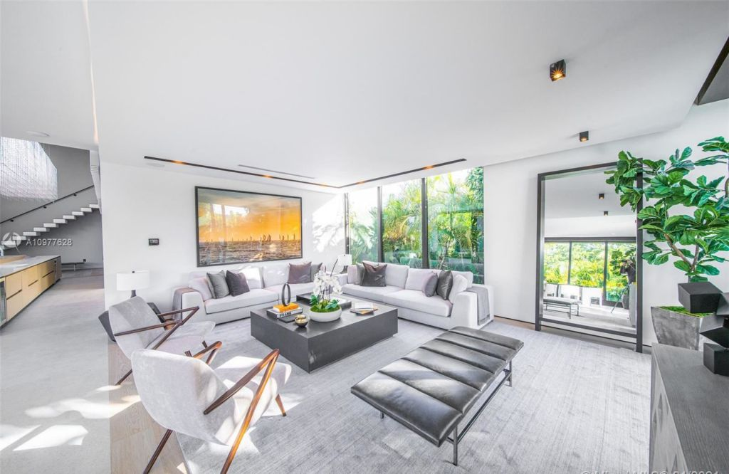 The Miami Beach House is a modern estate boasting opulence and sophistication sits in a quiet gated community now available for sale. This home located at 860 S Shore Dr, Miami Beach, Florida; offering 5 bedrooms and 6 bathrooms with over 5,000 square feet of living spaces.