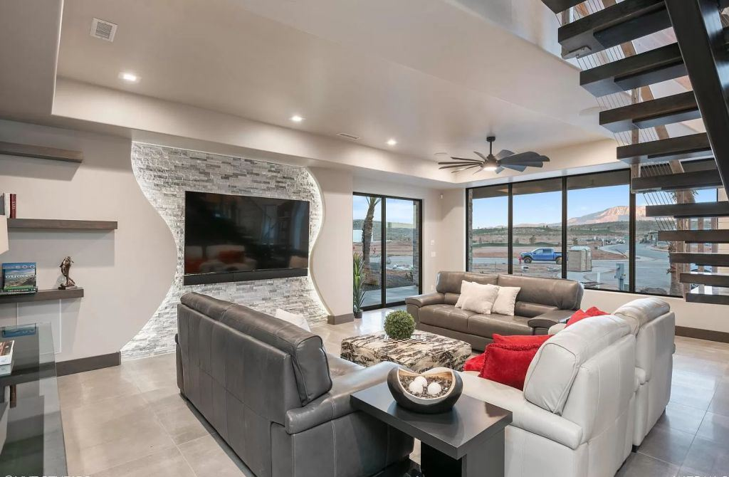 The Home in Utah is a luxurious home boasts the finest of finishes and taste in every square inch now available for sale. This home located at 3652 S Cypress Point Rd, Hurricane, Utah; offering 4 bedrooms and 5 bathrooms with over 6,000 square feet of living spaces.