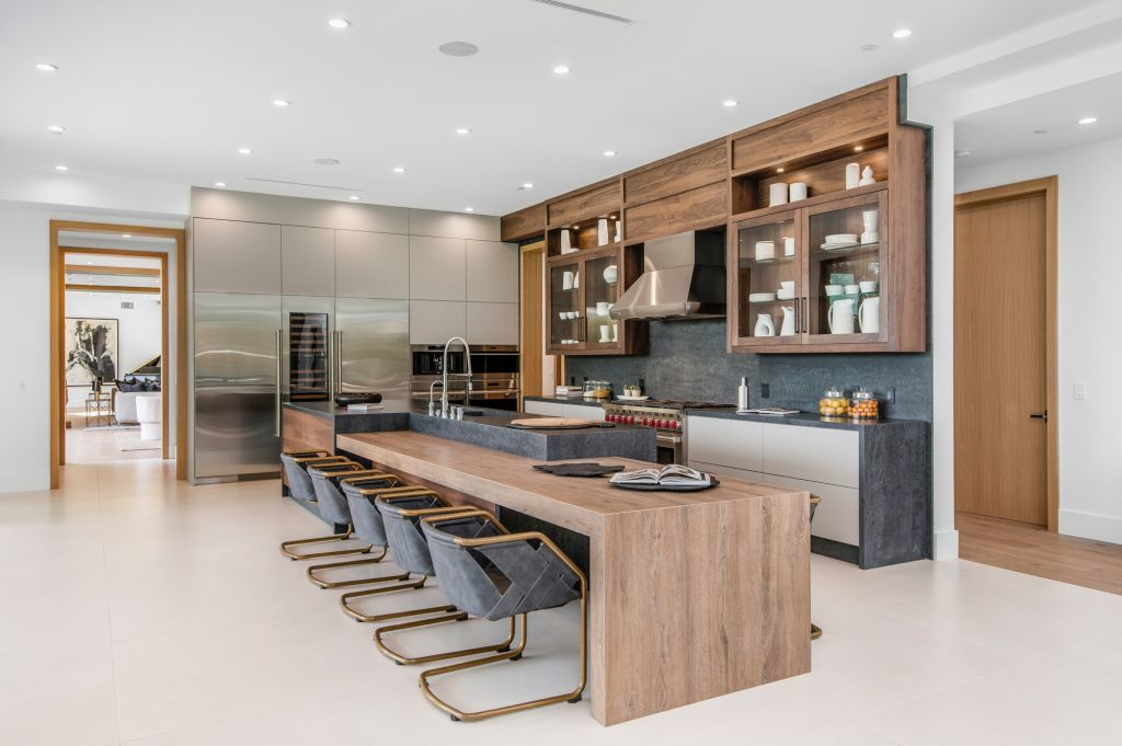 The House in Encino is a newly constructed contemporary masterpiece with unobstructed views in the coveted Royal Oaks now available for sale. This home located at 3950 Royal Oak Pl, Encino, California; offering 8 bedrooms and 14 bathrooms with over 13,000 square feet of living spaces