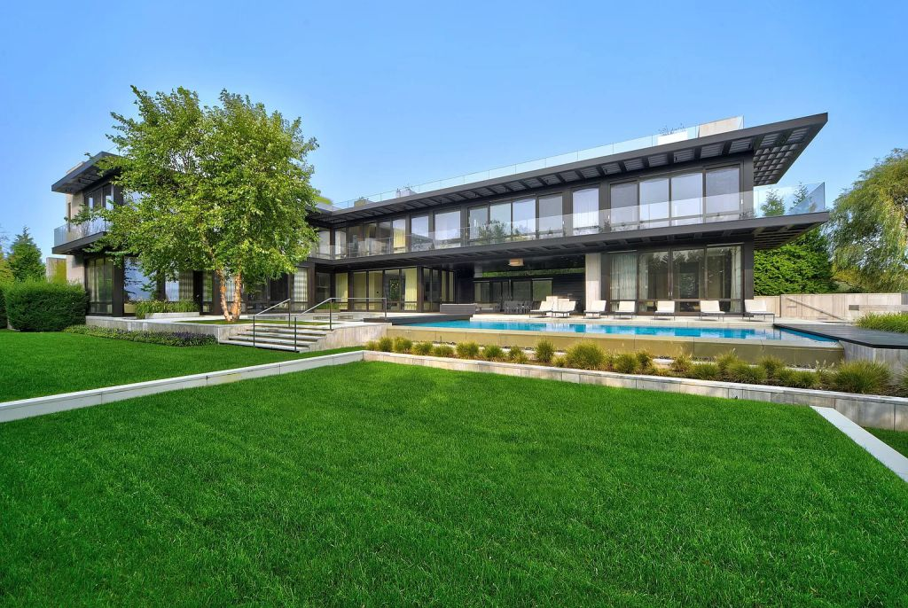 The Estate in New York is a luxurious modern estate recently completed near the ocean in Sagaponack now available for sale. This home located at 142 Crestview Ln, Sagaponack, New York; offering 8 bedrooms and 14 bathrooms with over 14,000 square feet of living spaces.
