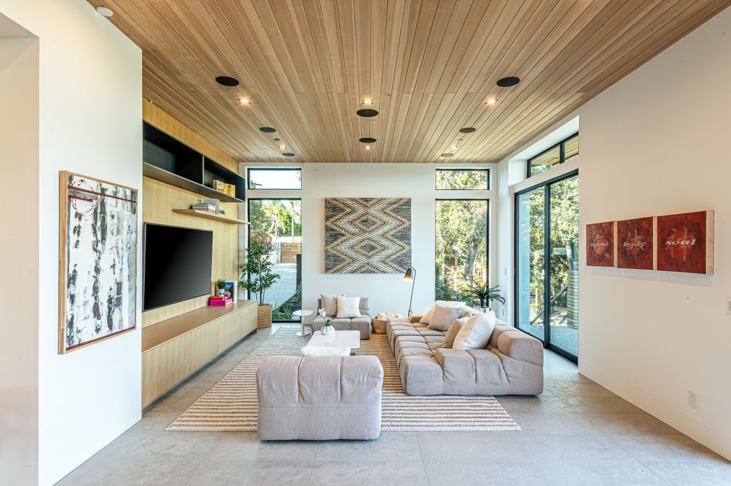 The Home for Sale in Encino is a architectural masterpiece with Exemplary exterior finishes include natural stone, cedar cladding. This home located at 16836 Marmaduke Pl, Encino, California; offering 7 bedrooms and 8 bathrooms with over 9,000 square feet of living spaces