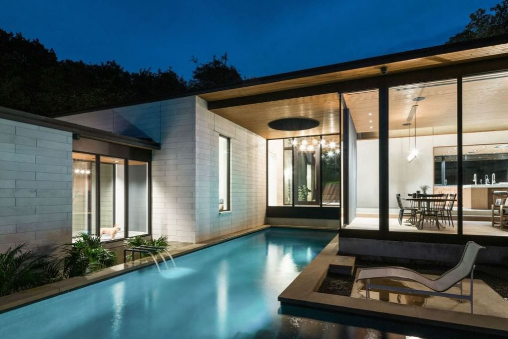 This Contemporary House in Austin, Texas, was designed by Ravel Architecture for clients in search of a quiet and private sanctuary; this house offers elegant living with fine finishes and smart amenities.
