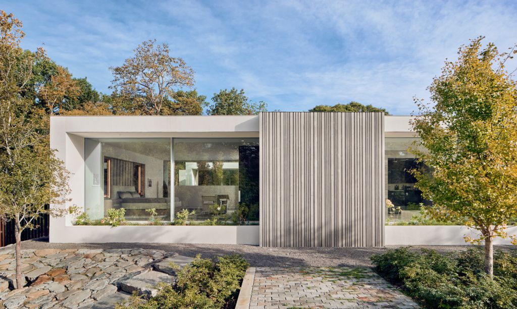 Preston Hollow Home in Dallas was designed by Specht Architects in Modern style from steel columns, frameless windows, and flowing water; this house providing a sense of privacy and seclusion from the street and surrounding neighborhood.