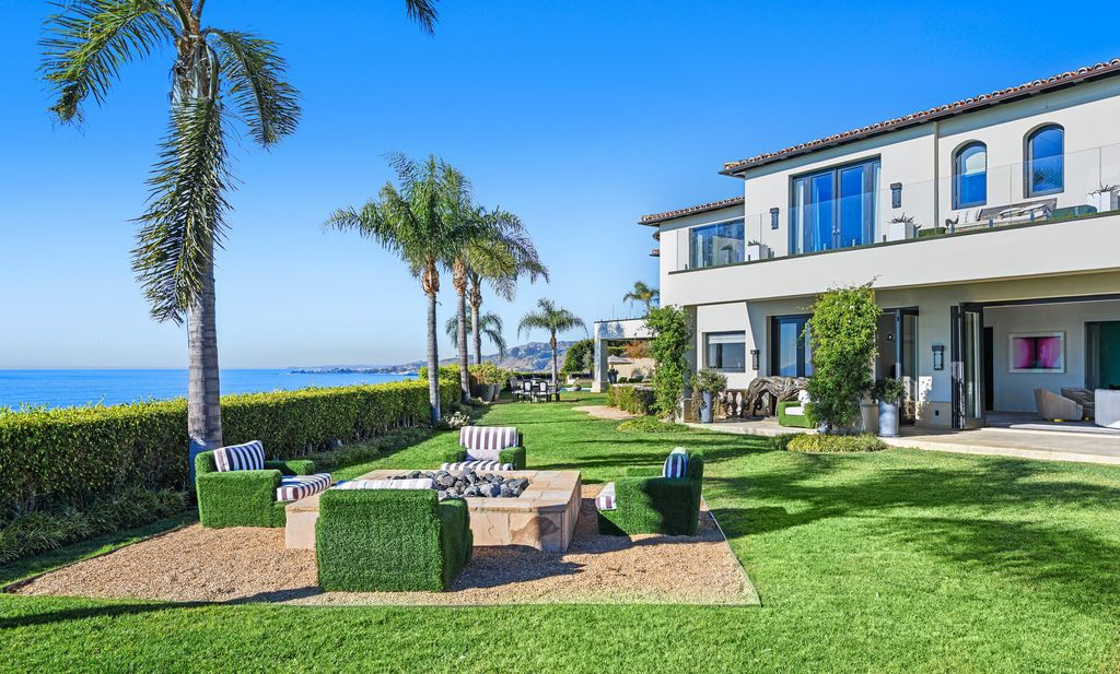 The Malibu Mansion is a private knoll top estate with exquisite finishes, superb quality, expansive views and lavish amenities now available for sale. This home located at 3905 Carbon Canyon Rd, Malibu, California; offering 6 bedrooms and 9 bathrooms with over 11,600 square feet of living spaces.