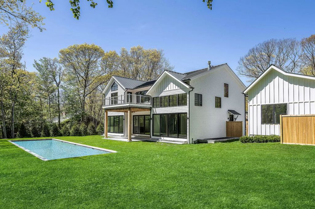 The East Hampton House is a newly constructed modern farmhouse on a prime half-acre parcel both aesthetically and functionally now available for sale. This home located at 51 Wireless Rd, East Hampton, New York; offering 6 bedrooms and 7 bathrooms with over 5,600 square feet of living spaces.