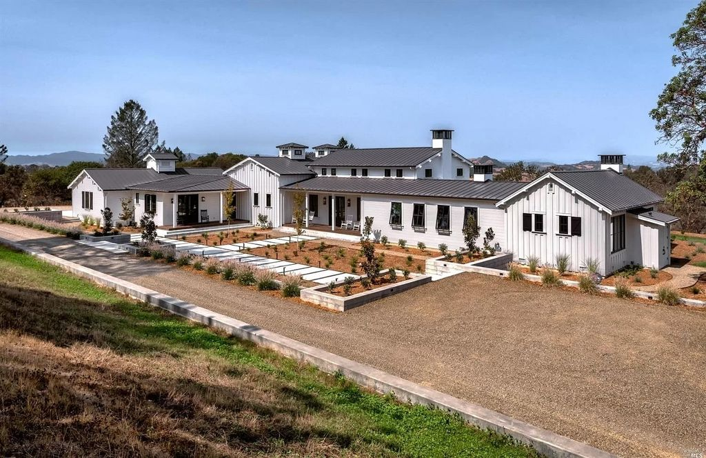 The Modern Farmhouse is a Newly Constructed Healdsburg Estate on a peaceful 77 acre parcel with incredible mountain and vineyard views now available for sale. This home located at 3171 Wright Ranch Ln, Healdsburg, California; offering 4 bedrooms and 5 bathrooms with over 4,500 square feet of living spaces.