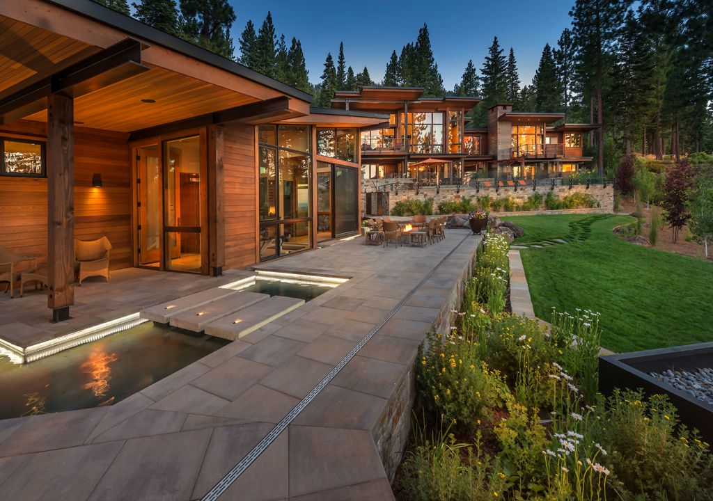 The Martis Camp House on Lot 595 in Truckee, California was designed by Walton Architecture + Engineering in contemporary mountain style; this house offers luxurious retreat with cozy finishes and smart amenities. This home located on beautiful lot with amazing mountain views and wonderful outdoor living spaces including patio, pool, garden.
