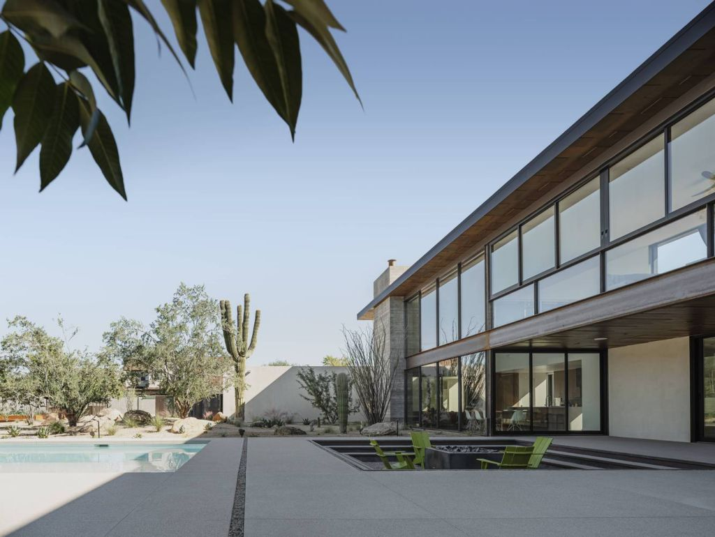 Foo House in Phoenix, Arizona was designed by The Ranch Mine in Modern desert style; this house designed for both pleasure and production. This home located on beautiful lot with amazing views and wonderful outdoor living spaces including patio, pool, garden