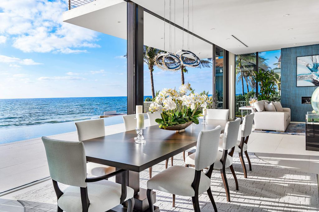 This Oceanfront Home in South Palm Beach, Florida was designed by Choeff Levy Fischman in tropical modern style with 5 bedrooms and 5 bathrooms; this house offers luxurious living with high end finishes and smart amenities. This home located on beautiful lot with amazing sea views and wonderful outdoor living spaces including patio, pool, garden.