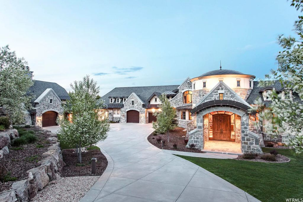 The Utah Mountain Home is surrounded by picturesque views of snow-capped mountains in the exclusive gated Glenwild Golf Community now available for sale. This home located at 8066 N Red Fox Ct, Park City, Utah; offering 5 bedrooms and 8 bathrooms with over 14,500 square feet of living spaces.