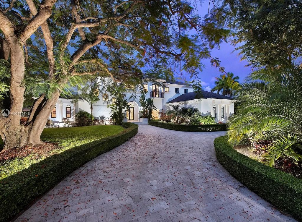 The Pinecrest Home is a classic and superior architectural design property with exquisite, finest modern finishes and details now available for sale. This home located at 13000 SW 63rd Ave, Pinecrest, Florida; offering 6 bedrooms and 8 bathrooms with over 8,800 square feet of living spaces.