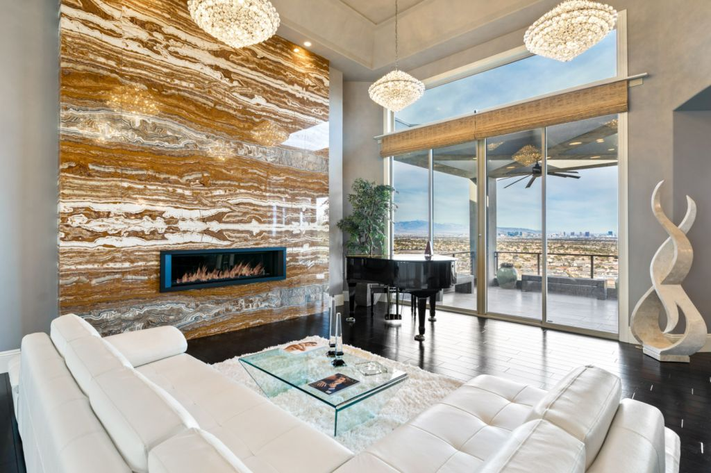 The Henderson House is a luxurious property with almost every room features unobstructed views now available for sale. This home located at 1508 View Field Ct, Henderson, Nevada; offering 4 bedrooms and 8 bathrooms with over 7,600 square feet of living spaces.