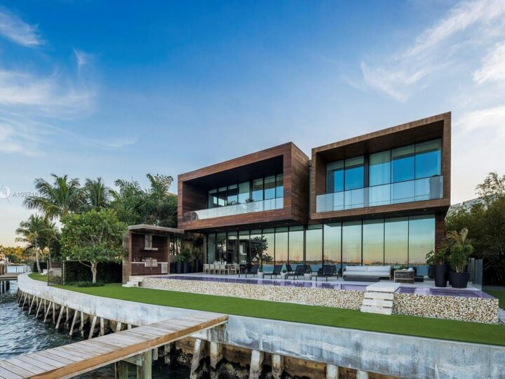 The Florida Mansion is a magnificent Venetian Islands estate with rich materials and bespoke details showcasing waterfront luxury living now available for sale. This home located at 835 E Di Lido Dr, Miami Beach, Florida; offering 7 bedrooms and 8 bathrooms with over 7,000 square feet of living spaces.