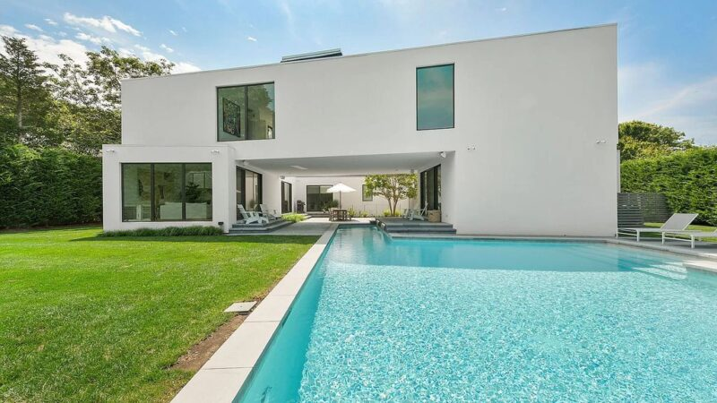 The Modern Beach House features uniquely private interior and exterior spaces, seamlessly integrating luxury with technology now available for sale. This home located at 74 Bluff Rd, Amagansett, New York; offering 5 bedrooms and 5 bathrooms with over 4,100 square feet of living spaces.