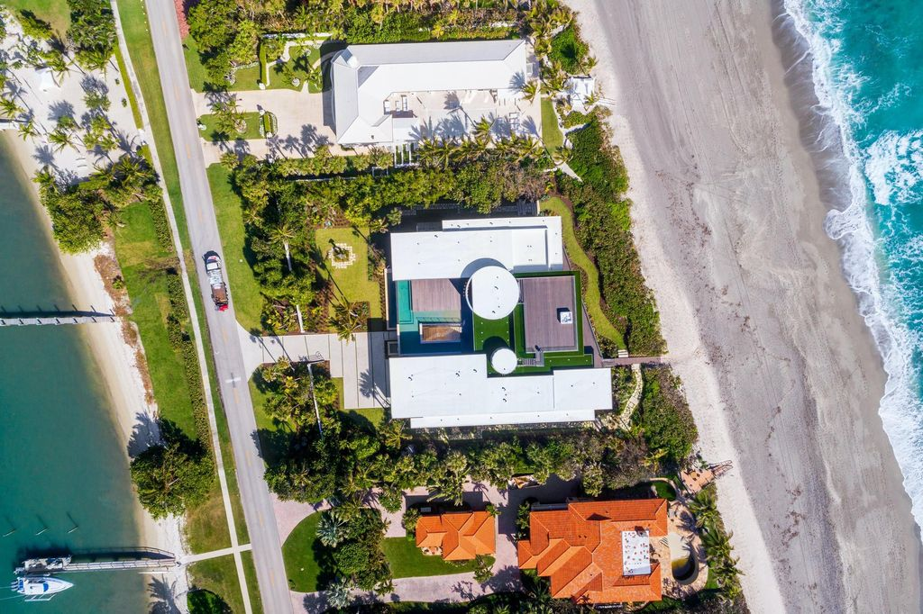 The Modern Mansion in Jupiter Island features spacious living and entertaining spaces with the most panoramic views of the Ocean now available for sale. This home located at 609 S Beach Rd, Jupiter, Florida; offering 6 bedrooms and 9 bathrooms with over 11,700 square feet of living spaces.
