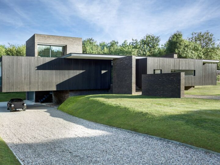 Black House in United Kingdom designed by AR Design Studio in Modern style; this house offers linear views across four carefully sculpted gardens. This home located on beautiful lot with amazing views and wonderful outdoor living spaces including patio, pool, garden.
