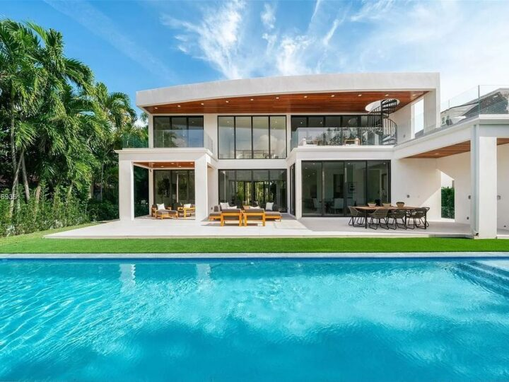 The Home in Miami Beach is a new construction modern oasis located on guard gated Hibiscus Island now available for sale. This home located at 112 W Palm Midway, Miami Beach, Florida; offering 5 bedrooms and 6 bathrooms with over 4,400 square feet of living spaces.