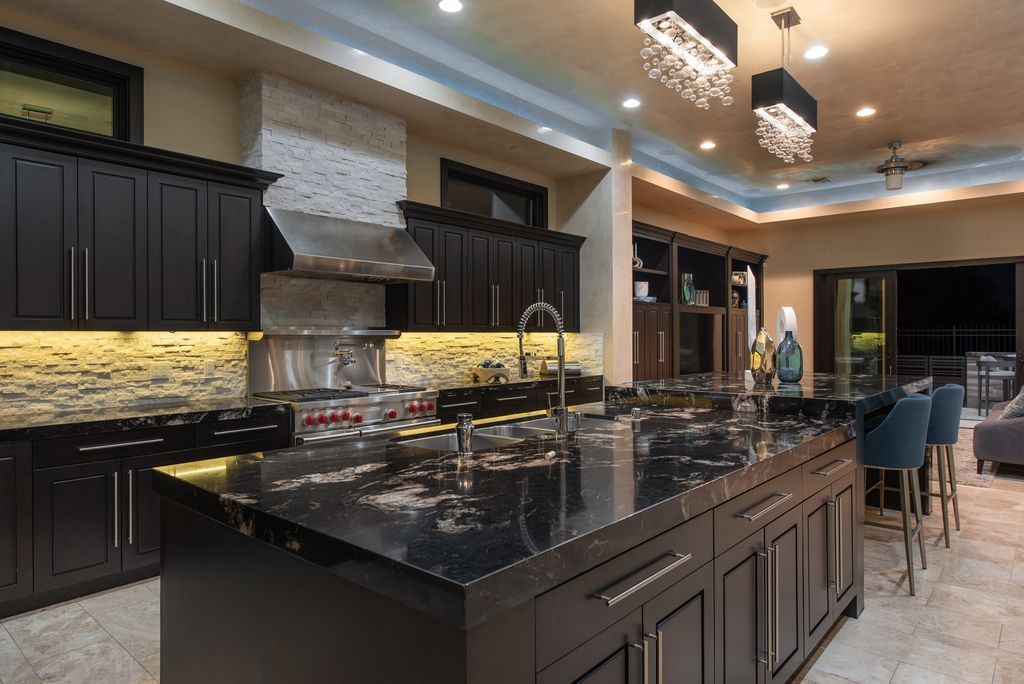 The Las Vegas Home in the much sought after Canyon Fairways guard gated community offering stunning mountain and golf views now available for sale. This home located at 9272 Tournament Canyon Dr, Las Vegas, Nevada; offering 6 bedrooms and 7 bathrooms with over 8,100 square feet of living spaces.