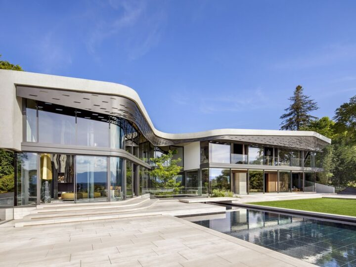 Modern Villa Courbe in Switzerland was designed by SAOTA in Modern style on spectacular lakeside setting perfect for private living and mix with the nature; this house offers luxurious living with high end finishes and smart amenities.