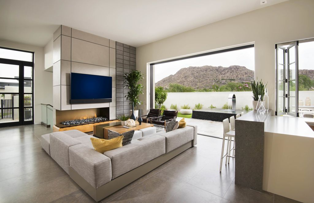 Desert Home in Desert Home, Arizona was designed by Candelaria Design in contemporary mountain style with 3 bedrooms and 4 bathrooms; this house offers luxurious living with high end finishes and smart amenities.
