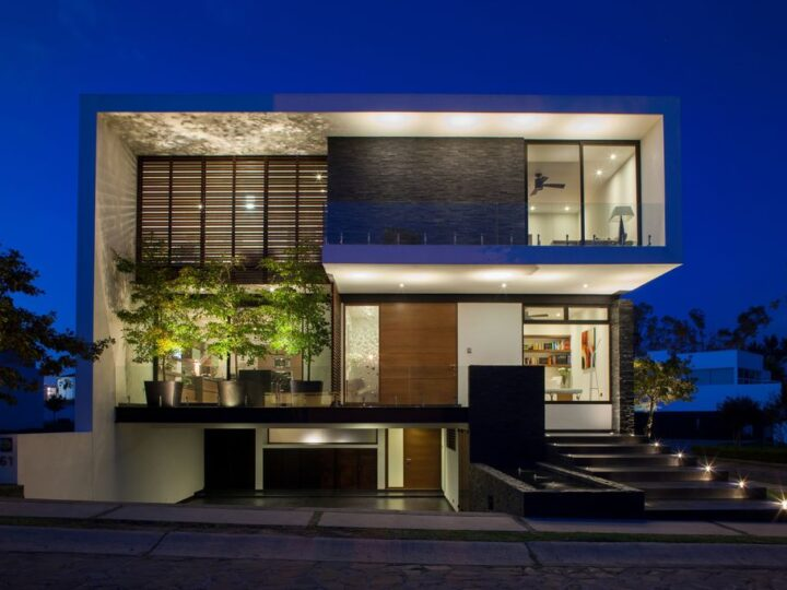 The GM House in Mexico was designed by GLR Architects in Modern style located on a corner in front of the access park of new urban area; this house offers luxurious living with high end finishes and smart amenities.