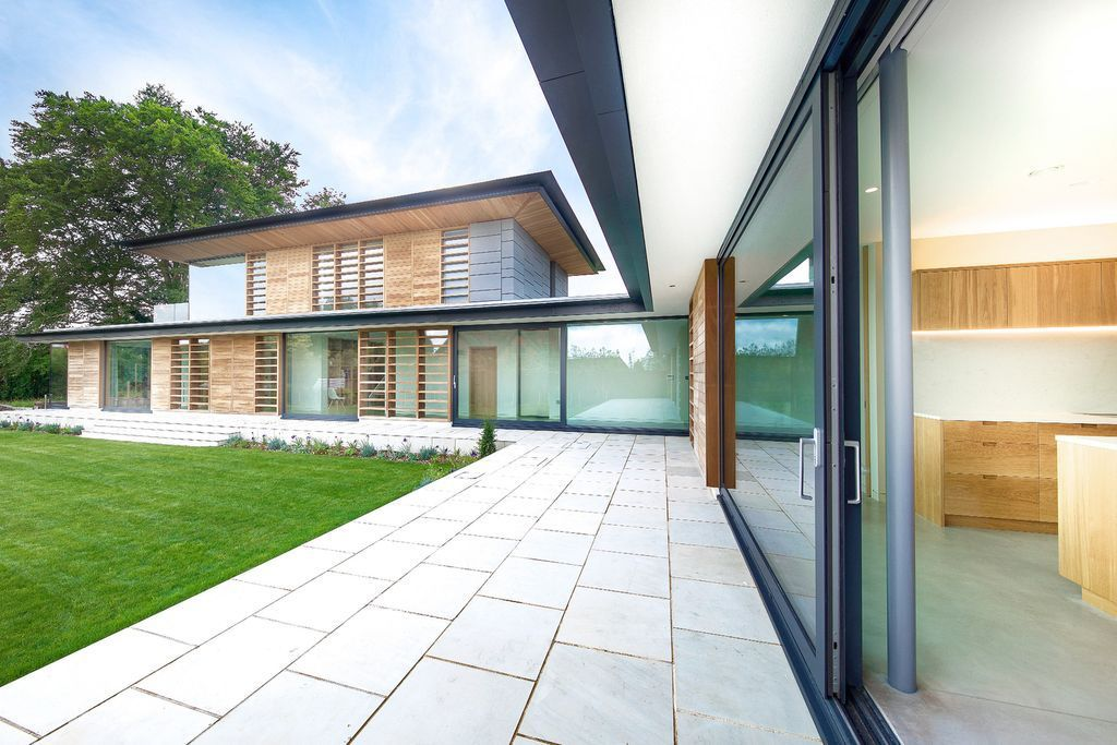 Holm Place Residence in United Kingdom was designed by OB Architecture in contemporary style with concept is to create an exemplary modern home. The design aims to have a direct relationship to the garden, maximizing light and blurring the threshold between inside and outside.