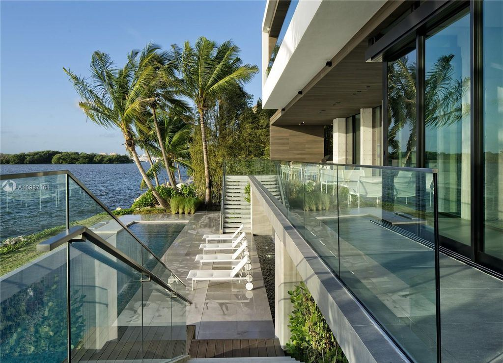 The Miami Waterfront Home is a sensational Biscayne Bay estate boasts open Bay Views now available for sale. This home located at 3591 Rockerman Rd, Miami, Florida; offering 5 bedrooms and 5 bathrooms with over 7,700 square feet of living spaces.