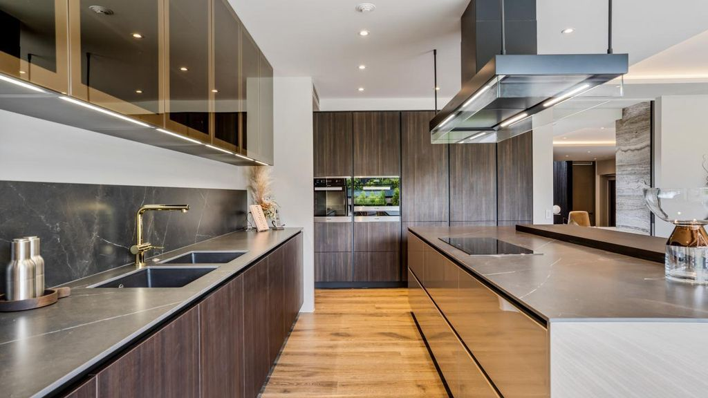 Paritai Drive House in New Zealand was designed by Jessop Architects in contemporary style with terrace landscaping at front side; this house offers luxurious living with high end finishes and smart amenities. This home located on beautiful lot with wonderful outdoor living spaces including patio, pool, garden.