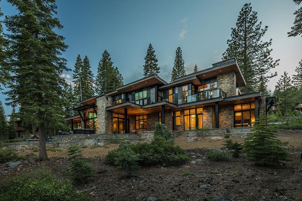 Martis Camp Home Lot 53 in Truckee, California was designed by Dennis Zirbel Architects in mountain contemporary style; this house offers impressive mountain views and expansive indoors and outdoors entertaining.