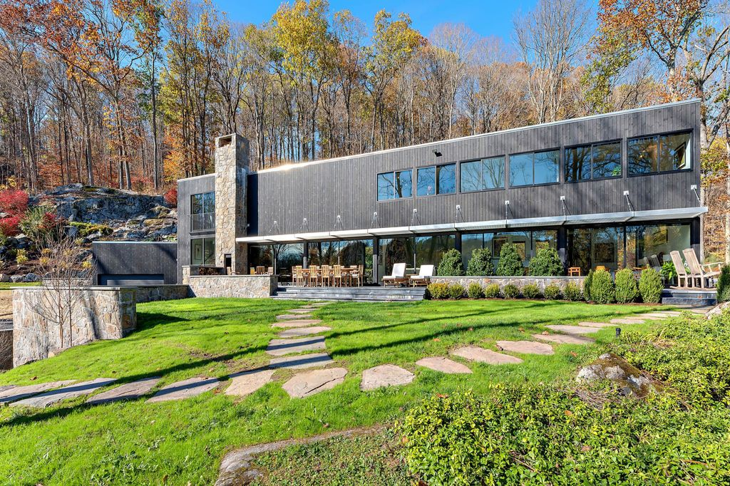 The Contemporary Home in Bedford perfectly sited on over 5 private, tranquil acres with sweeping drive and gated entry now available for sale. This home located at 147 Mianus River Rd, Bedford, New York; offering 5 bedrooms and 5 bathrooms with over 3,900 square feet of living spaces.