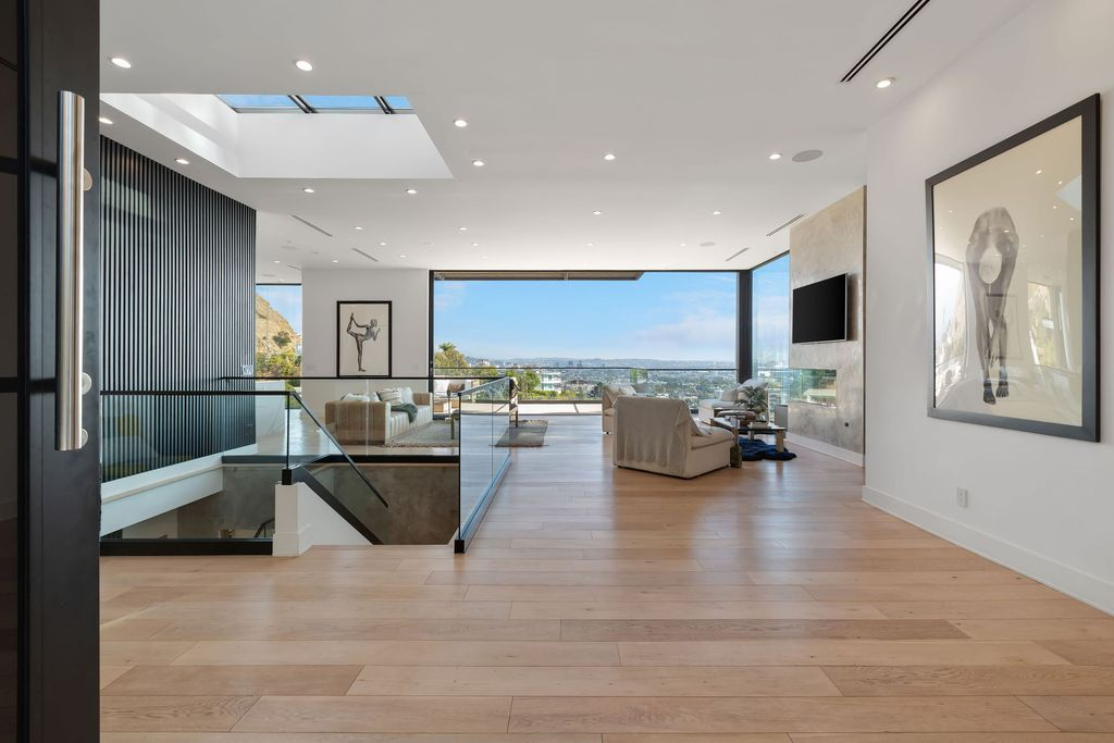 The Hollywood Hills Home is the pinnacle of luxury living showcasing unmatched explosive jetliner views now available for sale. This home located at 8428 Carlton Way, Los Angeles, California; offering 4 bedrooms and 6 bathrooms with over 5,300 square feet of living spaces.