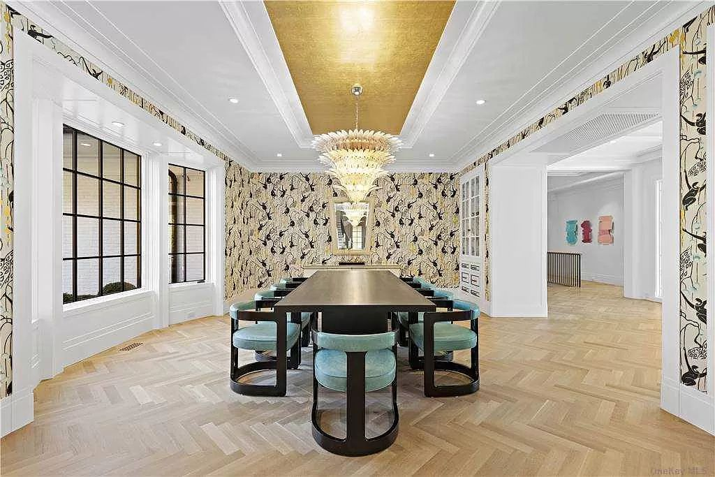 The New York Estate is an architectural trophy property juxtaposes clean modern lines and open living spaces now available for sale. This home located at 70 Bacon Rd, Old Westbury, New York; offering 6 bedrooms and 7 bathrooms with over 10,700 square feet of living spaces.