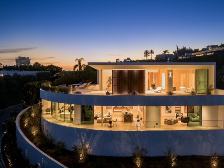 The Hollywood Hills Mansion is an amenity-rich entertainer's paradise within walking distance to the iconic Sunset Strip now available for sale. This home located at 1422 Devlin Dr, Los Angeles, California; offering 6 bedrooms and 10 bathrooms with over 10,000 square feet of living spaces.
