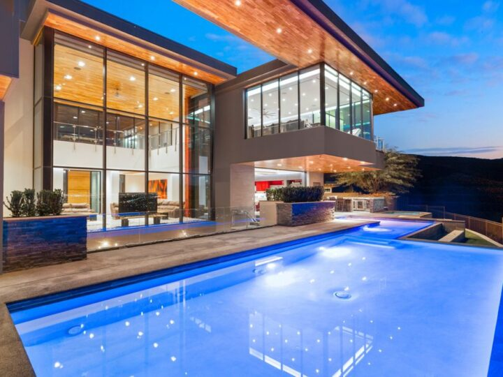 The Modern Home in the Las Vegas Valley is a distinctively modern estate offers a unique opportunity to live in a piece of art now available for sale. This home located at 7 Talus Ct, Henderson, Nevada; offering 6 bedrooms and 8 bathrooms with over 10,800 square feet of living spaces.