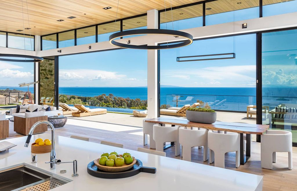 The Home in Malibu is a stunning architectural residence that's been meticulously crafted using high quality features with breathtaking views now available for sale. This home located at 3881 Puerco Canyon Rd, Malibu, California; offering 5 bedrooms and 6 bathrooms