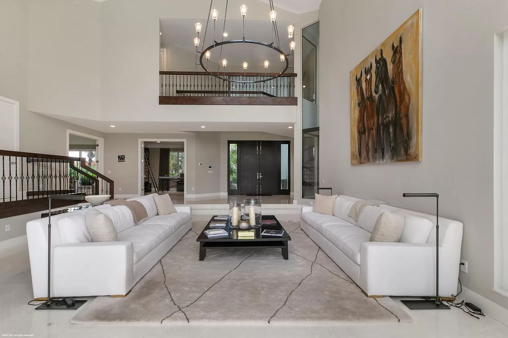 The Contemporary Home is a Beautifully remodeled 2 story home in Palm Beach Polo in relaxed elegance now available for sale. This home located at 2771 Long Meadow Dr, Wellington, Florida; offering 6 bedrooms and 7 bathrooms with over 8,300 square feet of living spaces.