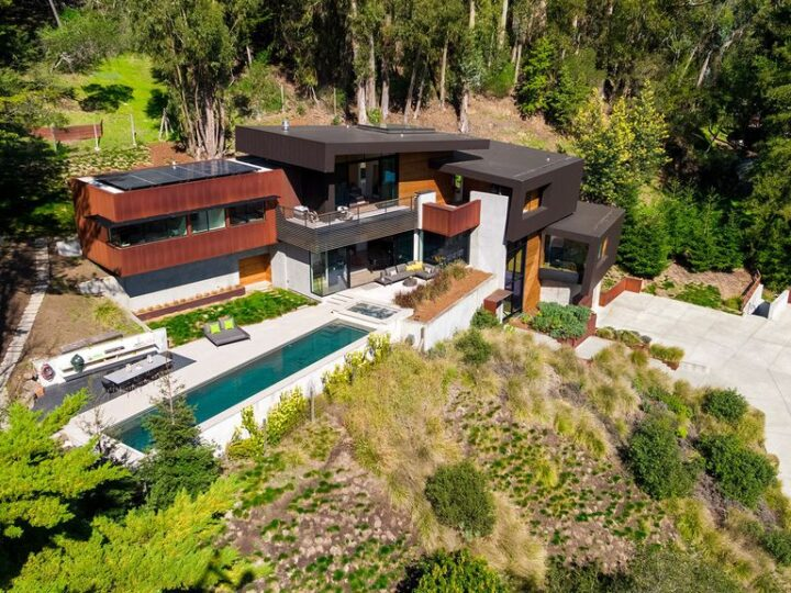 The Architectural Masterpiece in Mill Valley is as much an engineering marvel as it is an aesthetic homerun now available for sale. This home located at 432 Lovell Ave, Mill Valley, California; offering 6 bedrooms and 7 bathrooms with over 5,800 square feet of living spaces.