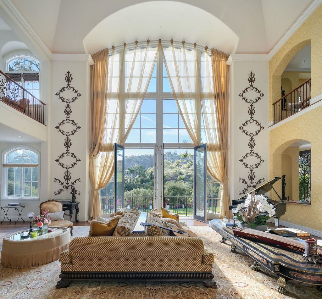 The Beverly Hills Mansion is a palatial estate boasts 13,405 square feet of unmatched scale and style now available for sale. This home located at 2650 Benedict Canyon Dr, Beverly Hills, California; offering 7 bedrooms and 9 bathrooms with over 13,000 square feet of living spaces.