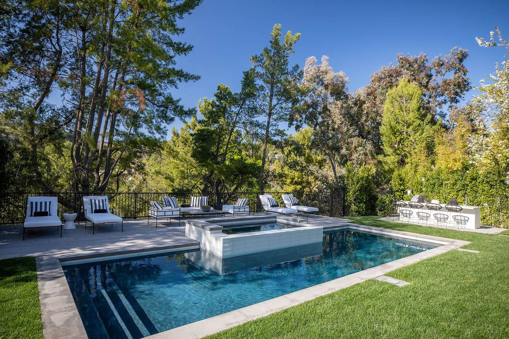 The Beverly Hills Home is a newly re-imagined estate with a sweeping open floor plan in a world class locale now available for sale. This home located at 9607 Wendover Dr, Beverly Hills, California; offering 5 bedrooms and 5 bathrooms with over 5,700 square feet of living spaces.