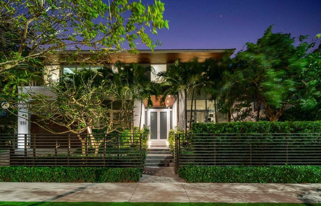 The Miami Beach Villa is a luxurious home perfect for entertaining with large manicured garden and full outdoor kitchen now available for sale. This home located at 1220 S Biscayne Point Rd, Miami Beach, Florida; offering 6 bedrooms and 6 bathrooms with over 5,400 square feet of living spaces.