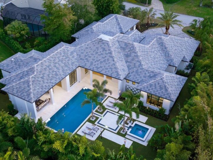 The Contemporary Home is perfectly complemented by lush mature tropical landscaping in the heart of Pelican Bay now available for sale. This home located at 810 Bentwood Dr, Naples, Florida; offering 4 bedrooms and 6 bathrooms with over 4,600 square feet of living spaces.