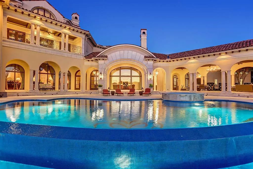 The Waterfront Home in Sugar Land is a palatial estate sits on its own private gated peninsula surrounded by water now available for sale. This home located at 11 Paradise Point Dr, Sugar Land, Texas; offering 6 bedrooms and 8 bathrooms with over 13,000 square feet of living spaces.
