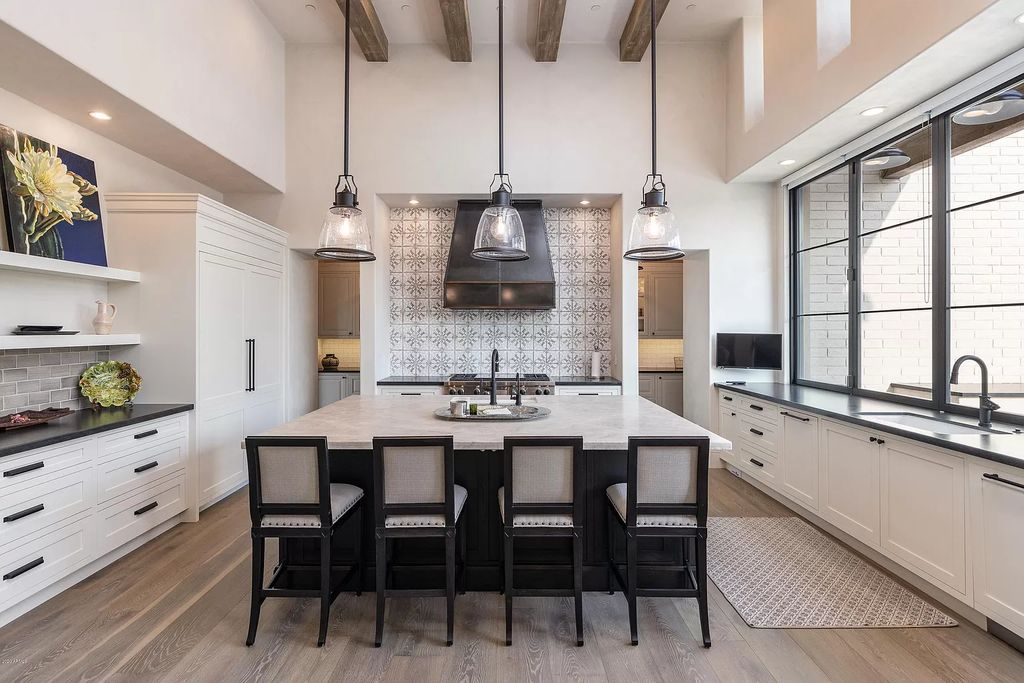 The Modern Hacienda in Coveted Paradise Valley is a luxurious custom home with remarkable quality & workmanship now available for sale. This home located at 5353 E Sanna St, Paradise Valley, Arizona; offering 5 bedrooms and 6 bathrooms with over 6,600 square feet of living spaces.