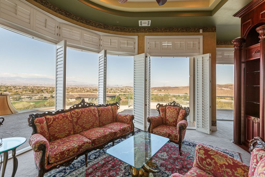 The Trophy Property in Henderson is an unique Design, modern and curved custom home sit atop a 200' plateau parcel available for sale. This home located at 45 Club Vista Dr, Henderson, Nevada; offering 7 bedrooms and 9 bathrooms with over 11,000 square feet of living spaces.