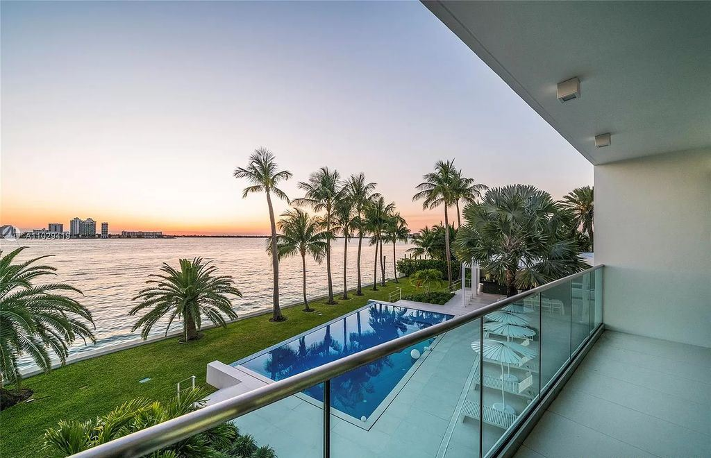 The Modern Mansion in Miami Beach is a stunning new 2-story waterfront estate and adjacent lot featuring resort style living now available for sale. This home located at 1050-1070 S Shore Dr #1070, Miami Beach, Florida; offering 6 bedrooms and 8 bathrooms with over 6,000 square feet of living spaces.
