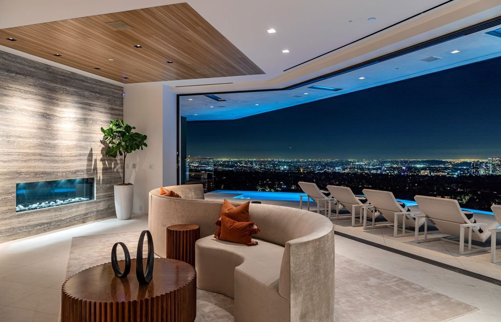 The Beverly Hills Mansion is a warm organic modern estate on one of the best promontories in Beverly Hills with unobstructed views now available for sale. This home located at 10102 Angelo View Dr, Beverly Hills, California; offering 4 bedrooms and 6 bathrooms with over 7,000 square feet of living spaces.